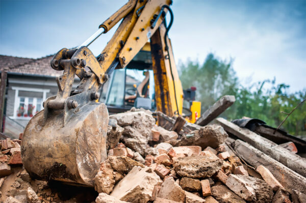 a digger demolishing a home to knockdown and rebuild
